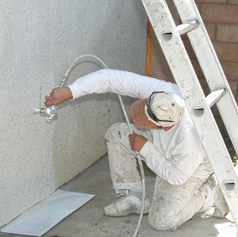 Spray painting stucco.