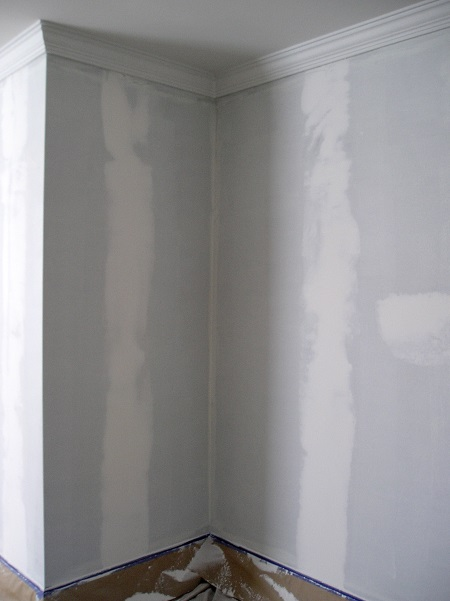 Example of walls patched and ready to paint after removing wallpaper.