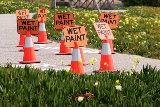 Wet paint signs & safety cones.
